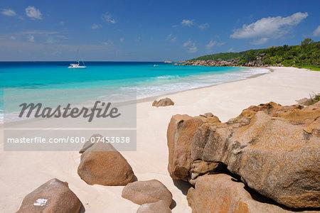 Sailboat in Ocean off Petit Anse Beach, La Digue, Seychelles