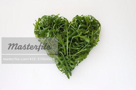 Heart-shaped formed by fresh Arugula