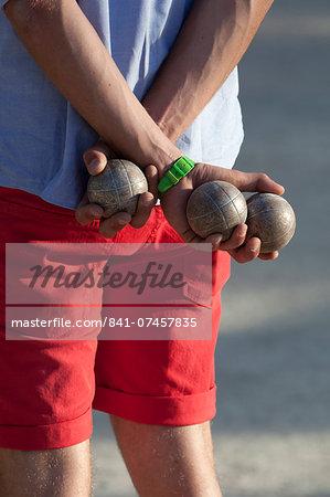 Man playing boules, Saint-Tropez, Var, Provence-Alpes-Cote d'Azur, France, Europe