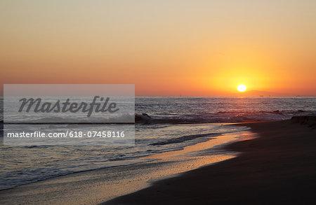 Setting sun on a Crystal Cove beach.