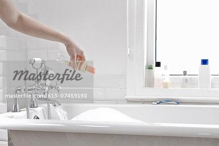 Woman preparing a bubble bath