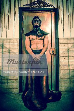 Man standing guard an evil door