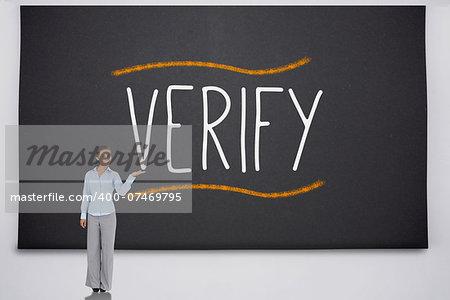 Businesswoman presenting the word verify