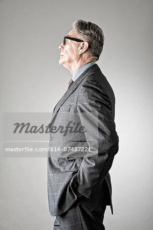 Portrait of senior man, wearing suit, side view