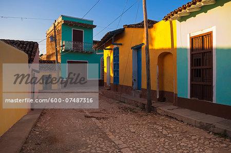 Colorful buildings on cobblestone street, Trinidad, Cuba, West Indies, Caribbean