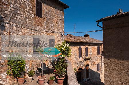 View of building with balcony garden, San Gimignano, Province of Siena, Tuscany, Italy
