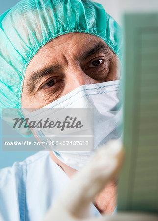 Close-up of Surgeon looking at Medical Chart