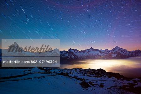 Europe, Valais, Swiss Alps, Switzerland, Zermatt, The Matterhorn (4478m) and town lights