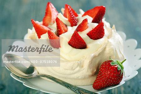 Dessert with lemon cream and strawberries closeup.
