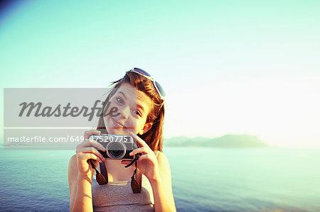 Portrait of girl holding camera on holiday, Kas, Turkey