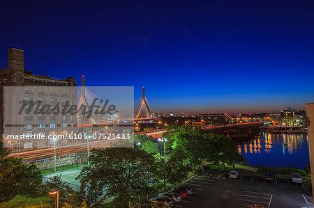 City lit up at dusk, Leonard P. Zakim Bunker Hill Bridge, North End, Boston, Massachusetts, USA