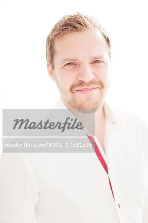 Portrait of man wearing suit, studio shot