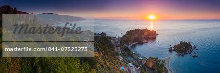 The Sicilian coast at sunrise, showing Isola Bella Beach, Taormina, Sicily, Italy, Mediterranean, Europe