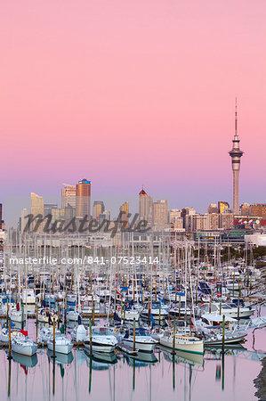 Westhaven Marina & city skyline illuminated at dusk, Waitemata Harbour, Auckland, North Island, New Zealand, Australasia