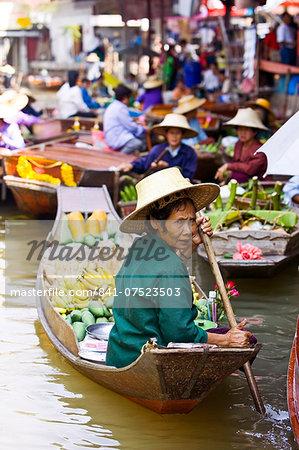 Fruit seller in the Damnern Saduak floating market, Bangkok, Thailand