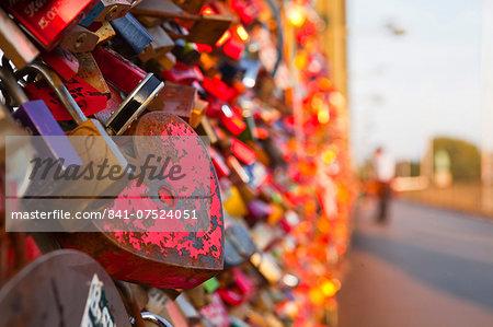 Love locks tied onto the railway bridge in Cologne, North Rhine-Westphalia, Germany, Europe