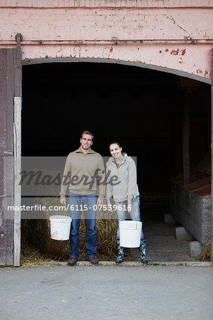 Young Couple Working On Farm, Croatia, Europe