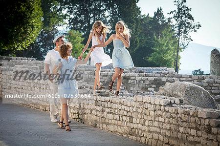Family takes a walk through Old Town ruins, Zadar, Croatia