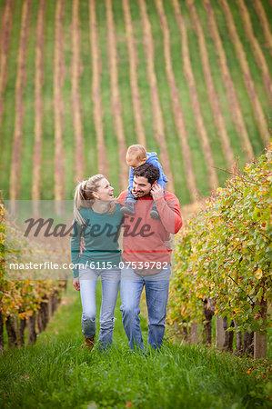 Family with one child walking in a vineyard, Osijek, Croatia