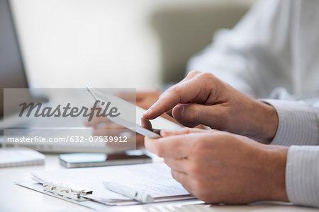 Man using digital tablet, cropped