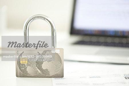 Credit card and lock representing internet security
