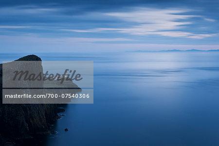 Neist Point Light House and the Inner Hebrides at dusk, Isle of Skye, Scotland