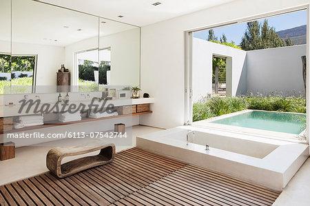 Modern bathroom overlooking luxury soaking pool