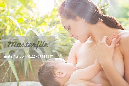 Mother breast-feeding baby boy