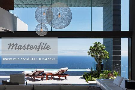 Lounge chairs on balcony overlooking ocean