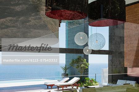 Patio of modern house overlooking ocean