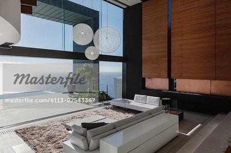 Living room in modern house overlooking ocean