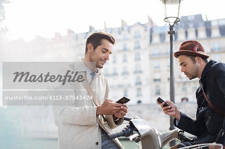 Businessmen using cell phones
