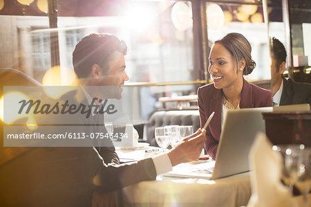Business people talking in restaurant