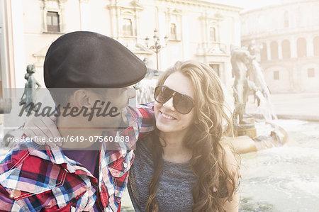 Tourist couple, Plaza de la Virgen, Valencia, Spain