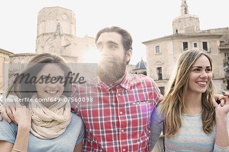Three young tourists, Plaza de la Virgen, Valencia, Spain