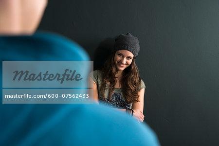 Teenage Girl and Young Man Talking, Studio Shot