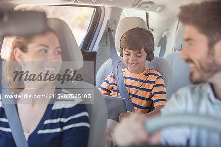 Happy family inside car