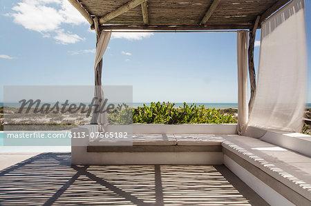 Luxury poolside patio overlooking ocean