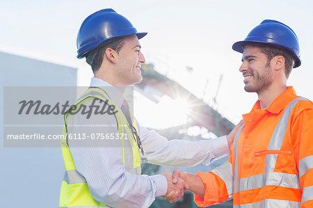 Businessman and worker handshaking