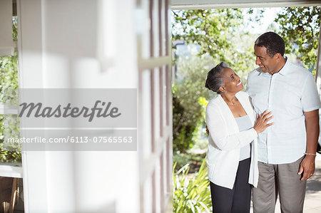 Senior couple hugging on patio