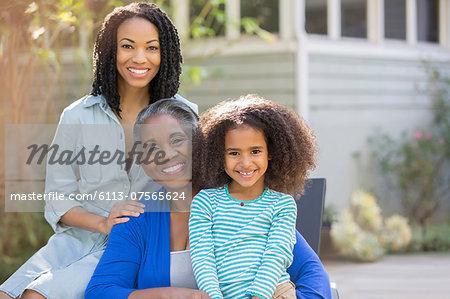 Portrait of smiling multi-generation women on patio