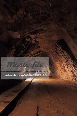 Long and dark tunnel in old uranium mine