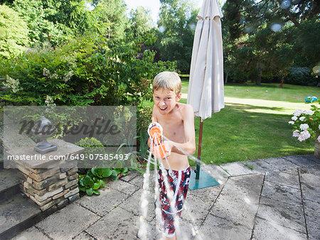 Boy squirting hose