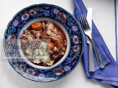 An antique plate of rabbit stew