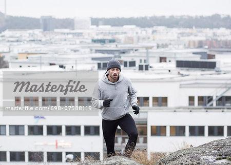 Man jogging against buildings