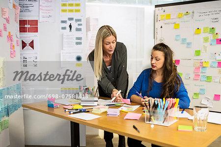 Businesswomen working together in creative office