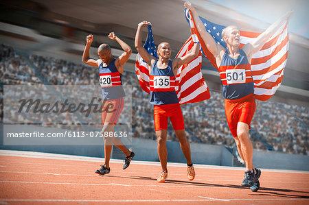 American athletes celebrating on track