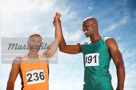 Athletes celebrating together on track