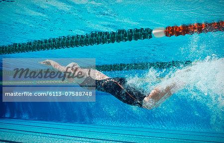 Swimmer racing underwater