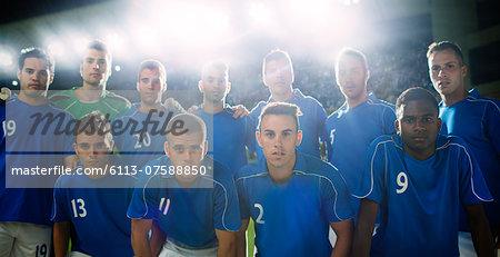 Soccer team standing in stadium